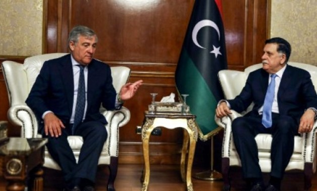 © AFP | European Parliament President Antonio Tajani (L) meets with Libya's unity government Prime Minister Fayez al-Sarraj at his office in the capital Tripoli on July 9, 2018