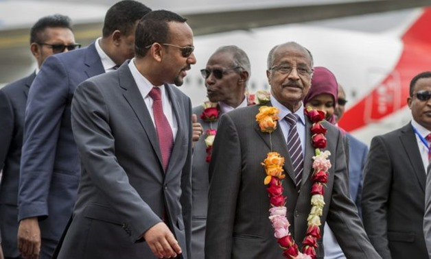 Ethiopia's Prime Minister Abiy Ahmed welcomes Eritrean Foreign Minister Osman Saleh and his delegation at the Bole International Airport in Addis Ababa, Ethiopia June 26, 2018 - Reuters