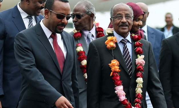 Ethiopia's Prime Minister Abiy Ahmed welcomes Eritrean Foreign Minister Osman Saleh at the Bole International Airport in Addis Ababa, Ethiopia, June 26 2018. Picture: REUTERS/ TIKSA NEGERI