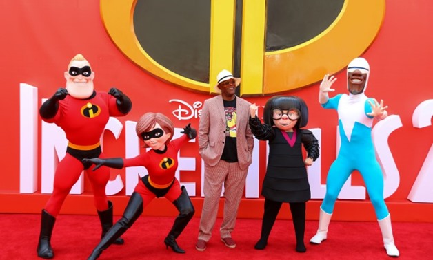 Actor Samuel L Jackson poses for photographs with characters from the flm as he arrives at the UK premiere of Incredibles 2 in London, Britain July 8, 2018. REUTERS/Simon Dawson