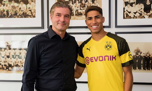 Achraf Hakimi with Borussia Dortmund jersey - Press image courtesy of Borussia Dortmund's official Twitter account