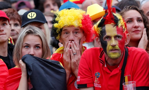 Soccer Football - World Cup - Semi-Final - France v Belgium - Brussels, Belgium - July 10, 2018. Belgium fans react as they watch the broadcast of the World Cup semi-final match between France and Belgium in the fan zone. REUTERS/Yves Herman TPX IMAGES OF