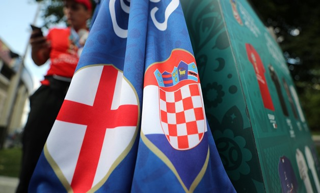 Soccer Football - World Cup - Semi Final - Croatia v England - Luzhniki Stadium, Moscow, Russia - July 11, 2018 England and Croatia flags outside the stadium before the match REUTERS/Carl Recine