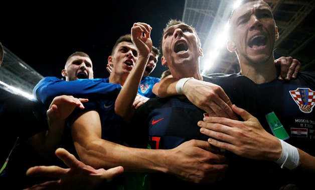 Soccer Football - World Cup - Semi Final - Croatia v England - Luzhniki Stadium, Moscow, Russia - July 11, 2018 Croatia's Mario Mandzukic celebrates scoring their second goal with teammates REUTERS/Carl Recine TPX IMAGES OF THE DAY