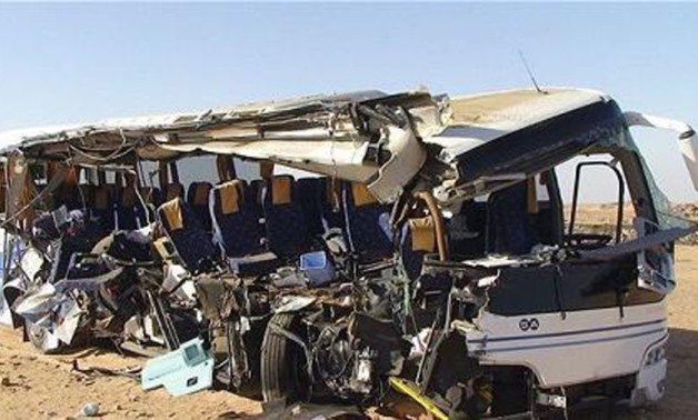At least 30 people were killed in a bus crash when two buses collided in Southern Egypt and a third one subsequently smashed into their wreckage, October, 13, 2014 – Reuters
