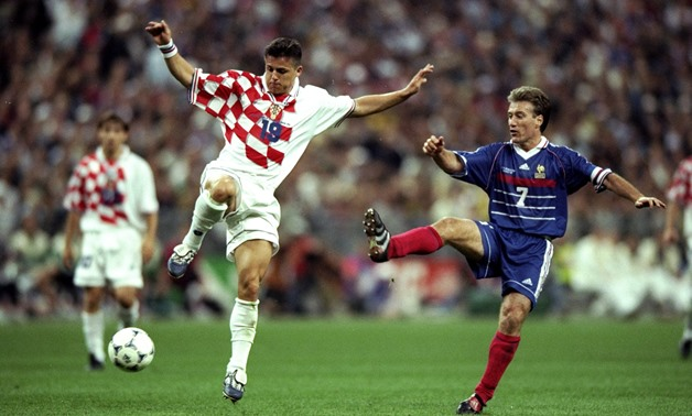 Croatia's Vlaović challenges France's Deschamps for the ball, photo courtesy of IFDB