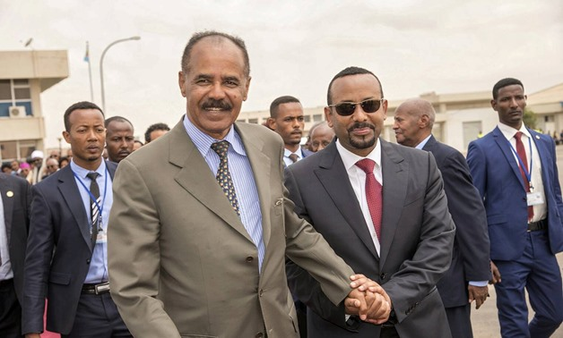 Eritrean President Isaias Afwerki and Ethiopia's Prime Minister Abiy Ahmed and walk together at Asmara International Airport, Eritrea July 9, 2018 in this photo obtained from social media on July 10, 2018. GHIDEON MUSA ARON VISAFRIC/via REUTERS