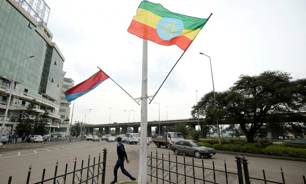 FILE PHOTO: A police officer walks past the flags of Ethiopia and Eritrea ahead of Eritrea's President Isaias Afwerki's visit to Addis Ababa, Ethiopia July 13, 2018. REUTERS/Tiksa Negeri/File Photo