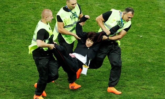 "Soccer Football - World Cup - Final - France v Croatia - Luzhniki Stadium, Moscow, Russia - July 15, 2018 Stewards apprehend a pitch invader REUTERS/Maxim Shemetov TPX IMAGES OF THE DAY SEARCH ""FIFA BEST"" FOR ALL PICTURES."
