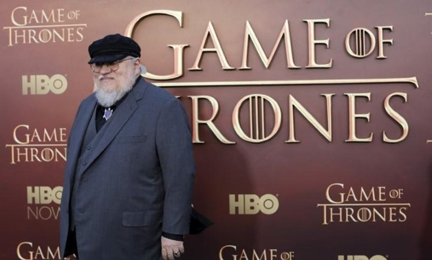 """FILE PHOTO: Co-executive producer George R.R. Martin arrives for the season premiere of HBO's """"Game of Thrones"""" in San Francisco, California March 23, 2015. REUTERS/Robert Galbraith/File Photo."""