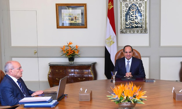 President Abdel Fatah al-Sisi (R) meets with Minister of State for Military Production, Dr. Mohamed El Assar. (L)- press photo