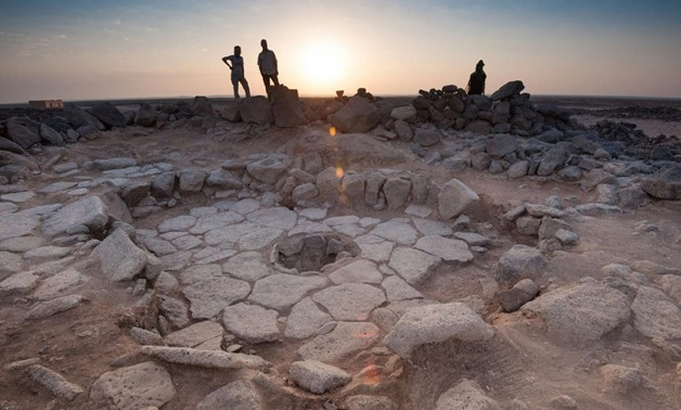 A stone structure at an archeological site containing a fireplace, seen in the middle, where charred remains of 14,500-year-old bread was found in the Black Desert, in northeastern Jordan in this photo provided July 16, 2018. Alexis Pantos/Handout via REU