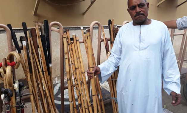 Sabri Sayed selling batons in Qus, Qena - Egypt Today/Wael Mohammed