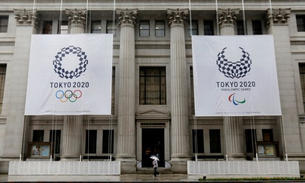 FILE PHOTO: Logos of Tokyo 2020 Olympics and Paralympics are seen on the Mitsui Main Building in Tokyo Japan, September 20, 2016. REUTERS/Toru Hanai/File Photo