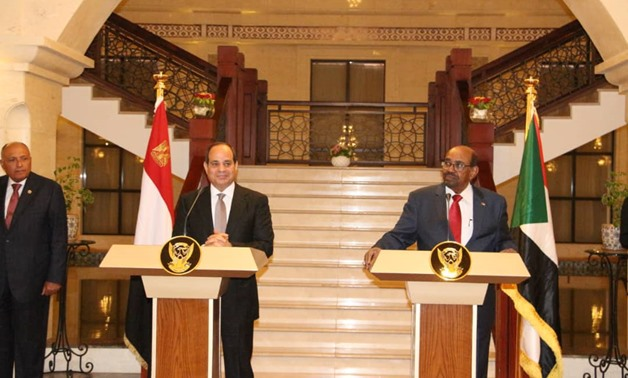 Egypt's President Abdel Fatah al-Sisi with Sudanese counterpart Omar Al-Bashir in Khartoum – press photo