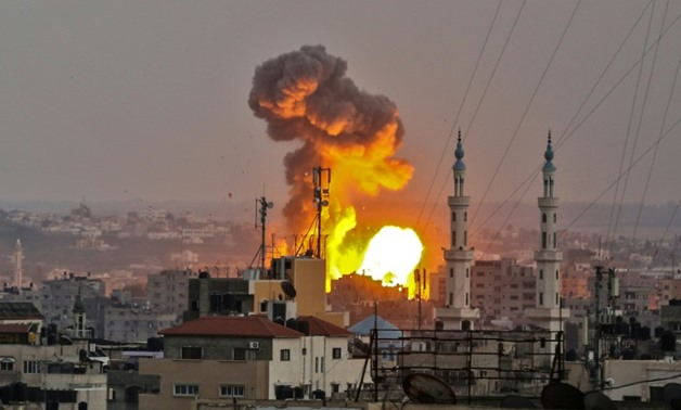 A fireball explodes in Gaza City during an Israeli bombardment on July 20, 2018 as months of tensions spiralled over into fresh violence
