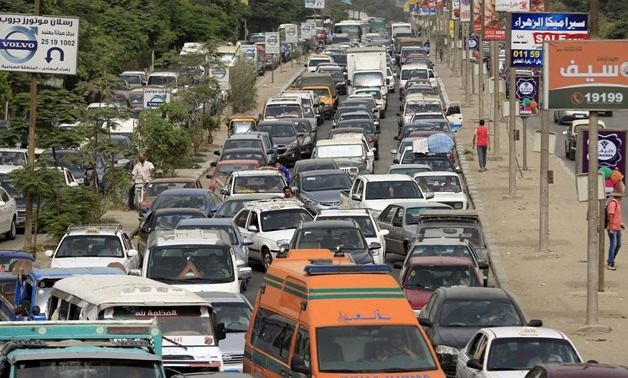Motorists stuck in a traffic jam on the outskirts of Cairo. REUTERS/Amr Abdallah Dalsh