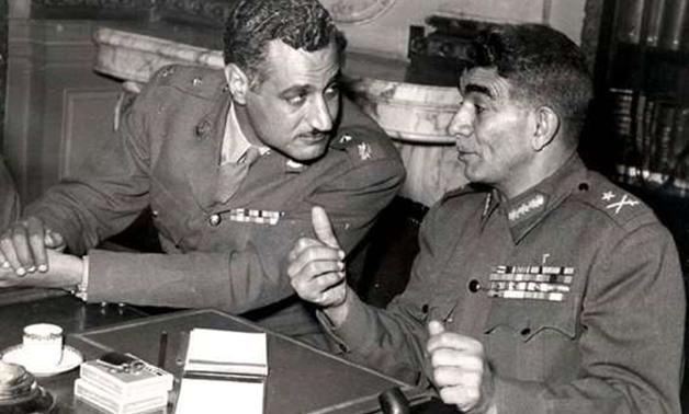 FILE – Gamal Abdel Nasser (L), Mohamed Naguib (R)