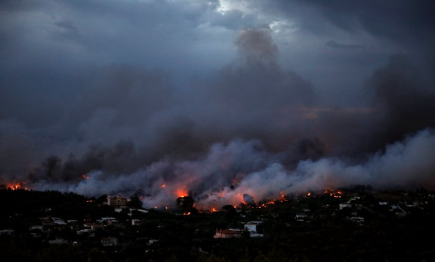 A wildfire rages in the town of Rafina, near Athens, Greece, July 23, 2018. REUTERS/Alkis Konstantinidis