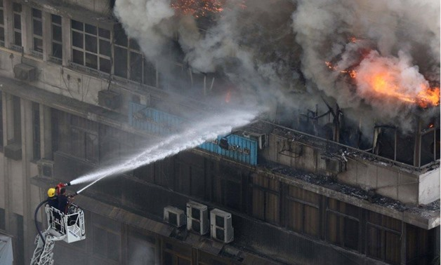 A fire broke out at the Syndicate of Commercial Professions' top floor located in Ramses street in Cairo, July, 24, 2018 - Egypt Today