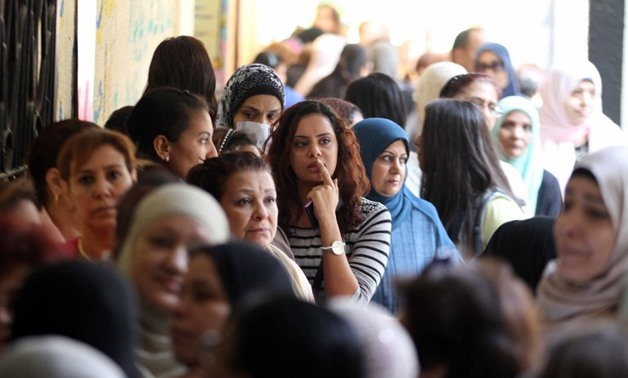 Egyptian women queue at a polling station in the capital Cairo on Nov. 22, 2015, on the first day of the second and final round of the country's parliamentary elections - AFP