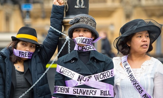 Domestic workers dressed as suffragettes demand the right to be able to change employers once in the UK at a protest in London in 2015. The change was made but campaigners claim it has not been properly implemented. Photograph: Dominic Lipinski/AFP