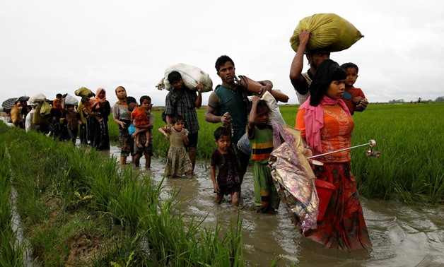 A group of Rohingya refugee people walk in the water after crossing the Bangladesh-Myanmar border in Teknaf, Bangladesh, September 1, 2017. REUTERS/Mohammad Ponir Hossain