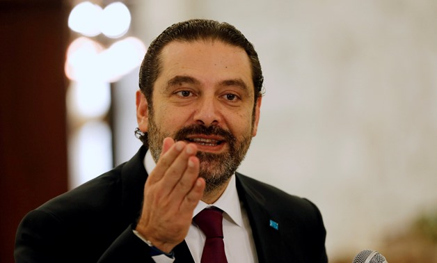 FILE PHOTO:Lebanese Prime Minister-designate Saad al-Hariri gestures as he talks at the presidential palace in Baabda, Lebanon June 22, 2018. REUTERS/Mohamed Azakir/File Photo