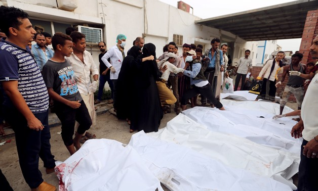 Relatives of victims gather around their bodies outside a hospital morgue after an air strike hit a fish market in Hodeidah, Yemen August 2, 2018. REUTERS/Abduljabbar Zeyad
