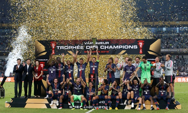 Soccer Football - French Super Cup Trophee des Champions - Paris St Germain v AS Monaco - Shenzhen Universiade Sports Centre, Shenzhen, China - August 4, 2018 Paris St Germain celebrate with the trophy after winning the French Super Cup REUTERS/Bobby Yip