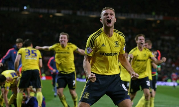 Central defender Ben Gibson move to Premier League side Burnley cost them a joint club record fee of £15million to prise the former England Under-21 international away from second tier English outfit Middlesbrough on a four year contract AFP / NIGEL RODD