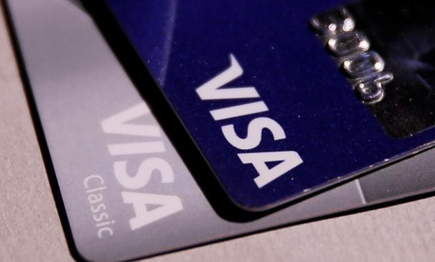 Visa credit cards are seen in this picture illustration taken June 9, 2016. REUTERS/Maxim Zmeyev/Illustration/File Photo