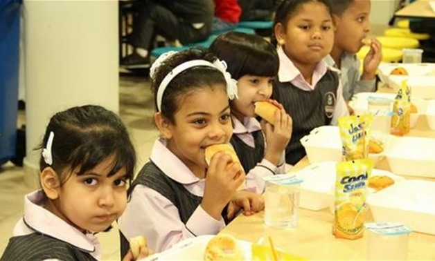 FILE – Students eating school meals