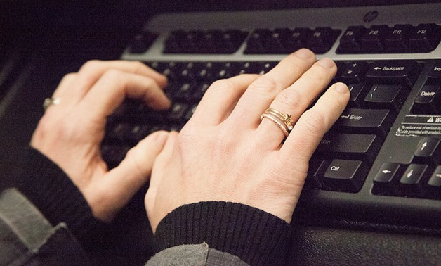 Person typing on a computer keyboard – Flickr/Wellness Corporate Solutions