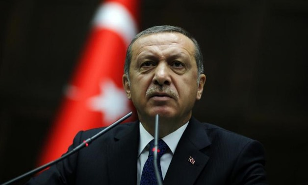 FILE- Turkey's Prime Minister Tayyip Erdogan addresses members of parliament from his ruling AK Party during a meeting at the Turkish parliament in Ankara June 3, 2014. Credit: Reuters/Umit Bektas