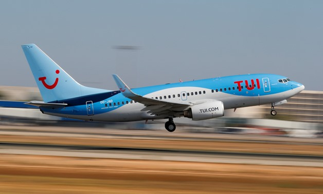 FILE PHOTO: A TUI fly Belgium Boeing 737-700 airplane takes off from the airport in Palma de Mallorca, Spain, July 29, 2018. Picture taken July 29, 2018. REUTERS/Paul Hanna/File Photo