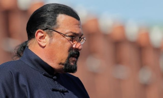 FILE PHOTO: U.S. actor Steven Seagal watches the Victory Day parade, marking the 73rd anniversary of the victory over Nazi Germany in World War Two, at Red Square in Moscow, Russia May 9, 2018. REUTERS/Maxim Shemetov/File Photo.