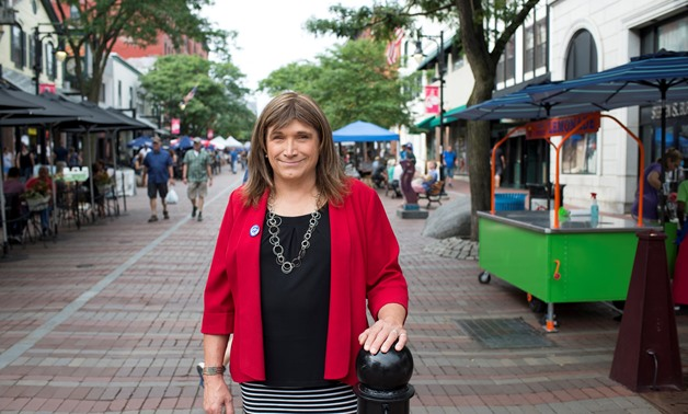 Vermont Democratic Party gubernatorial primary candidate Christine Hallquist, a transgender woman, poses as she campaigns on Church Street in Burlington, Vermont, U.S., August 8, 2018. Picture taken August 8, 2018. REUTERS/Caleb Kenna