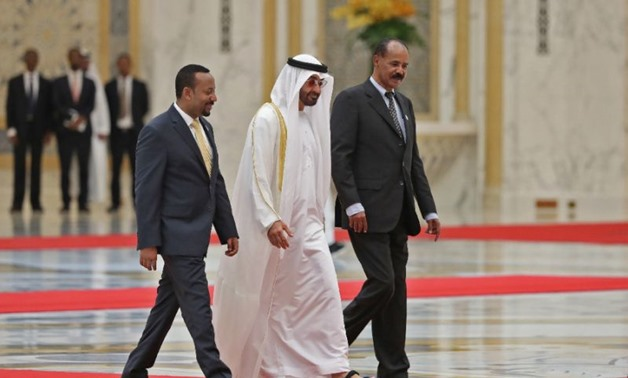Abu Dhabi's Crown Prince Sheikh Mohamed bin Zayed Al-Nahyan (C) receives Ethiopian Prime Minister Abiy Ahmed (L) and Eritrean President Isaias Afwerki (R) at the presidential palace in the UAE capital on July 24, 2018 (AFP Photo/KARIM SAHIB)