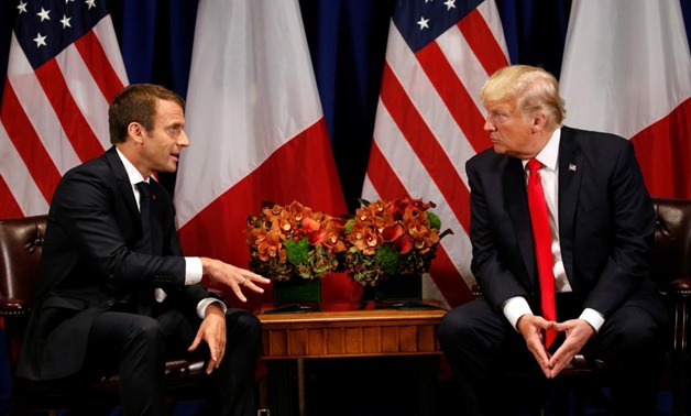 President Donald Trump with French President Emmanuel Macron - Reuters