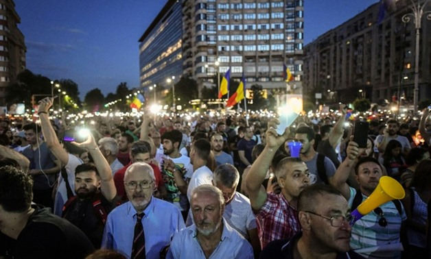 Massive crowds gathered in downtown Bucharest for a second straight night to protest corruption