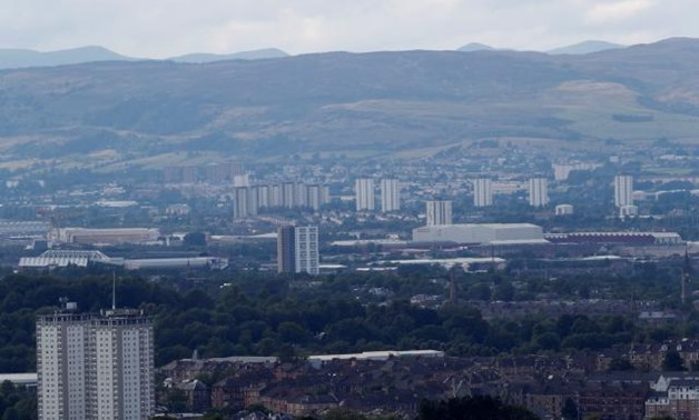 Blocks of flats in the city of Glasgow are seen from Cathkin Braes, Scotland, Britain August 7, 2018. REUTERS/Russell Cheyne