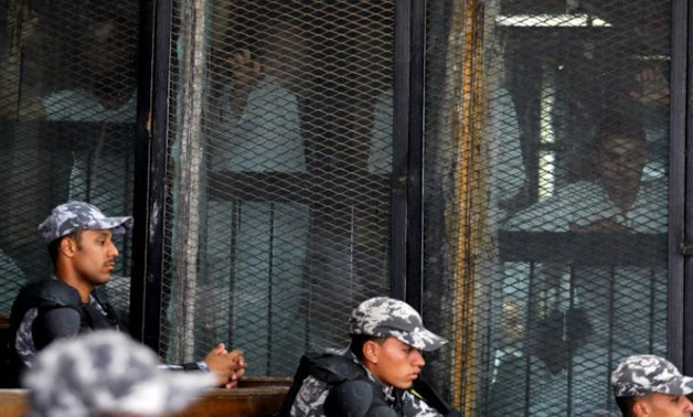 Defendants and police at the Cairo Criminal Court. Reuters file photo