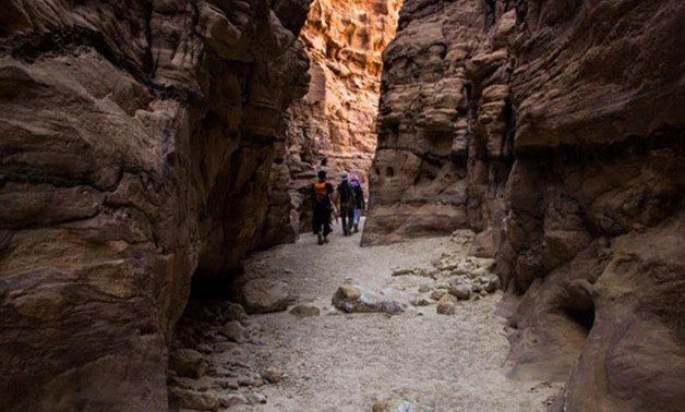 Tourists are walking through the mountains in Darb Sinai -        Press photo