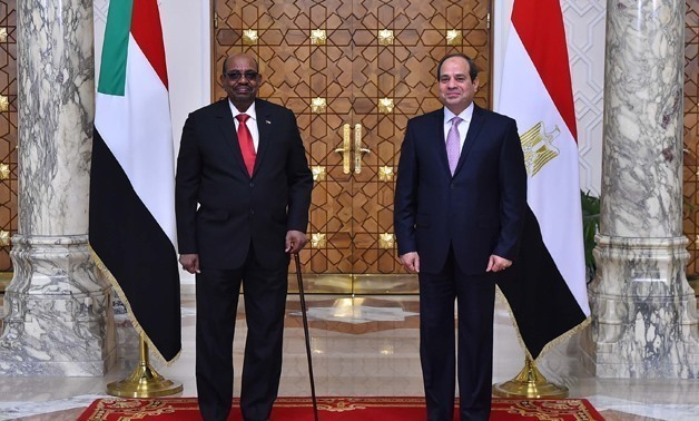 Egypt's President Abdel Fatah al-Sisi with Sudanese counterpart Omar Al-Bashir in Khartoum – File photo
