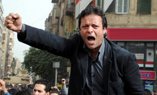 FILE - Hisham Abdullah protests in Al-Tahrir square