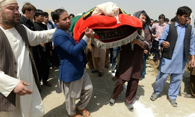 Afghan Shiite mourners buried the dead on Thursday from a suicide attack on an education centre the day before, even as gunmen launched another attack in war-weary Kabul