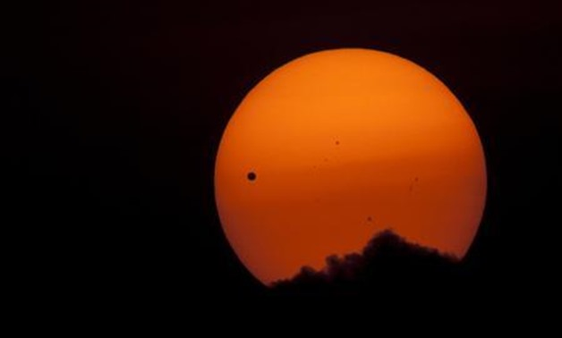 The planet Venus makes its transit across the Sun as seen from Kathmandu June 6, 2012. Venus made a slow transit across the face of the sun on Tuesday - Reuters