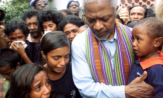 FILE PHOTO - United Nations Secretary-General Kofi Annan consoles family members of victims of last April's massacre by pro-Indonesia militia in Liquisa, 30 km west of DIli February 17, 2000. REUTERS/Darren Whiteside