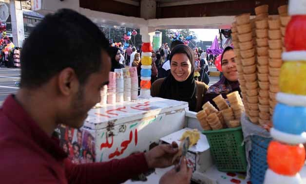 Young women buying ice cream, celebrating Eid al-Adha in Cairo - Photo by Ahmed Maarouf/Egypt Today